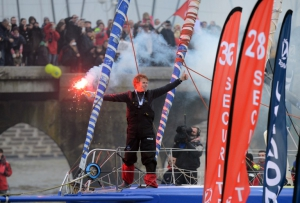 French skipper François Gabart celebrates after winning the 7th edition of the Vendee Globe solo round-the-world race on January 27, 2013 off the coasts of Les Sables d'Olonne, western France. Gabart, 29, is the youngest skipper in the event. He set a new record with 78 days 02 h and 16 min, beating the previous record time set at 84 days 3hr 9min by 2009 winner Michel Desjoyeaux. AFP PHOTO DAMIEN MEYER / AFP / DAMIEN MEYER